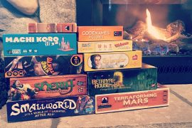 Stack of Board Games by Fireplace